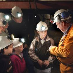Crowd of visitors in coal mine